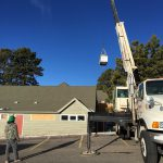 A big truck hoist is needed to lift the new heating unit into place on the roof - 3/17
