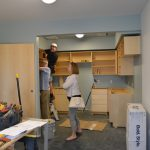 Weekend volunteers install kitchen cabinets - 7/8/17