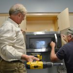 Volunteers install a new Microwave oven in the kitchen - 9/2/17