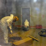 Workers Suited Up removing asbestos laden flooring