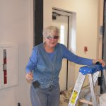 Saturday volunteer painting a doorway - 8/26/17